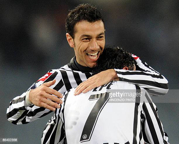 Udinese's foward Fabio Quagliarella celebrates with teammate foward Simone Pepe after scores against Zenith Saint Petersburg during their UEFA cup...