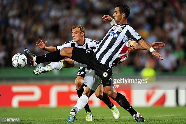 Udinese's French defender Benatia Al Mouttaqui Mehdi Amine is challenged by Arsenal's forward of Dutch Robin van Persie next to Udinese's Sweden...