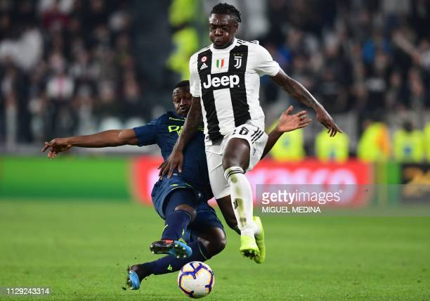Udinese's Ghanaian defender Nicholas Opoku tackles Juventus' Italian forward Moise Kean during the Italian Serie A football match Juventus vs Udinese...