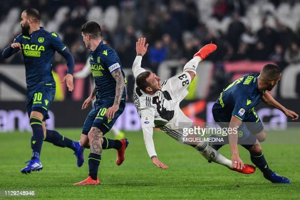 Udinese's Iraqi defender Ali Adnan tackles Juventus' Italian forward Federico Bernardeschi during the Italian Serie A football match Juventus vs...