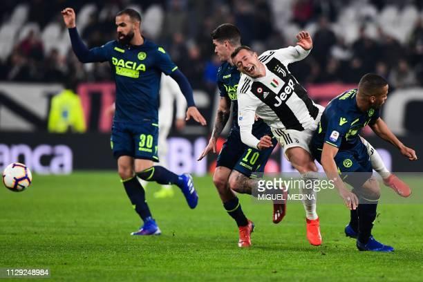 Udinese's Iraqi defender Ali Adnan tackles Juventus' Italian forward Federico Bernardeschi during the Italian Serie A football match Juventus vs...