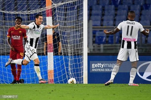 Udinese's Italian forward Kevin Lasagna celebrates after opening the scoring during the Italian Serie A football match Roma vs Udinese played on July...