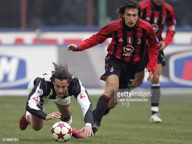 Udinese's midfielder Stefano Mauri is tackled by AC Milan's midfielder Andrea Pirlo, during their Italian serie A football match at San Siro stadium...
