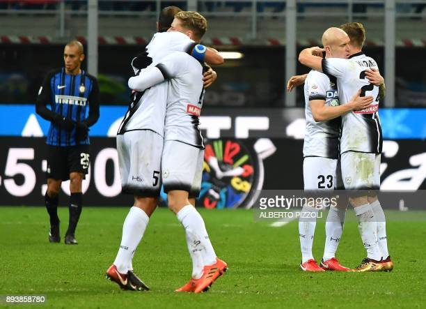 Udinese's players celebrate at the end of the Italian Serie A football match Inter Milan vs Udinese on December 16 2017 at Meazza San Siro stadium in...