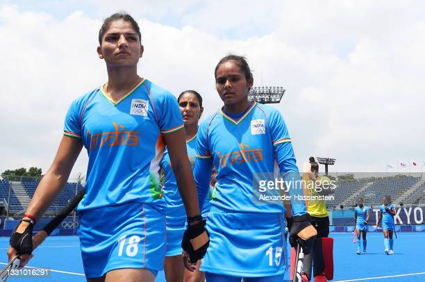 Udita, Nisha and members of Team India walk off the field after losing 4-1 the Women's Preliminary Pool A match between Great Britain and India on...