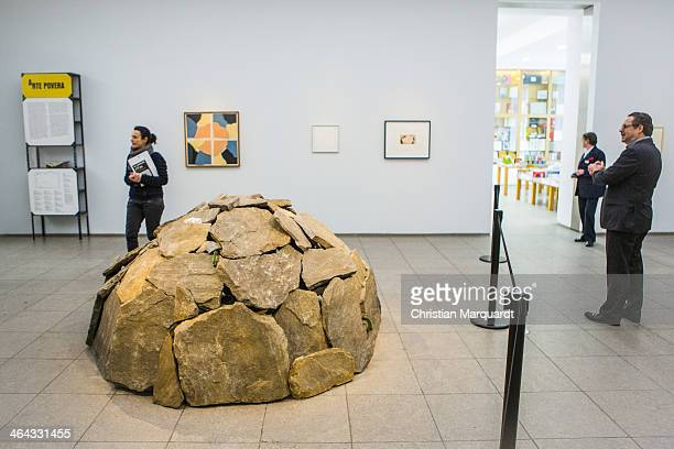 Udo Kittelmann stands next to the work of 'Mario Merz' during the press opening of the exhibition 'AZ Die Sammlung Marzona' at Hamburger Bahnhof on...