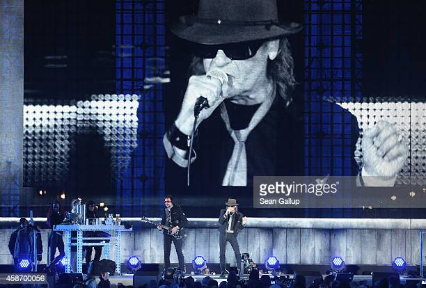 Udo Lindenberg performs at the Brandenburg Gate during celebrations on the 25th anniversary of the fall of the Berlin Wall on November 9 2014 in...