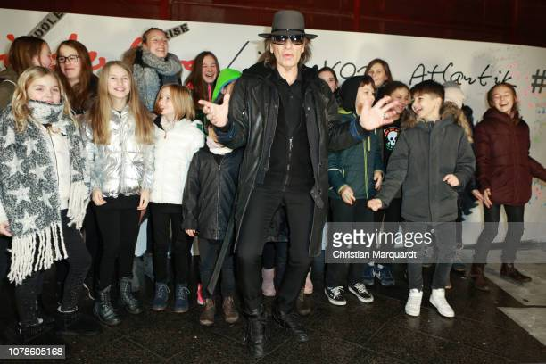 Udo Lindenberg poses during the unveiling of the 'Friedenswand' a picture created by four artists and singer Udo Lindenberg at Alexanderstrasse on...