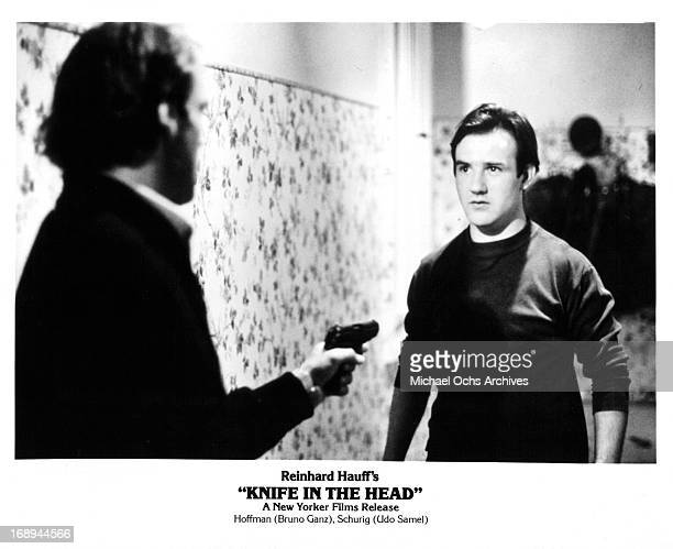 Udo Samel points a gun at Bruno Ganz in a scene from the film 'Knife In The Head' 1978