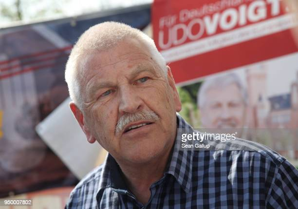 Udo Voigt European Parliament member of the farright NPD politicial party speaks to the media at the venue of a neoNazi music fest on April 21 2018...