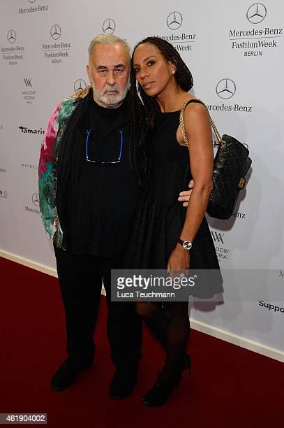 Udo Walz and Barbara Becker attend the Guido Maria Kretschmer show during the MercedesBenz Fashion Week Berlin Autumn/Winter 2015/16 at Brandenburg...