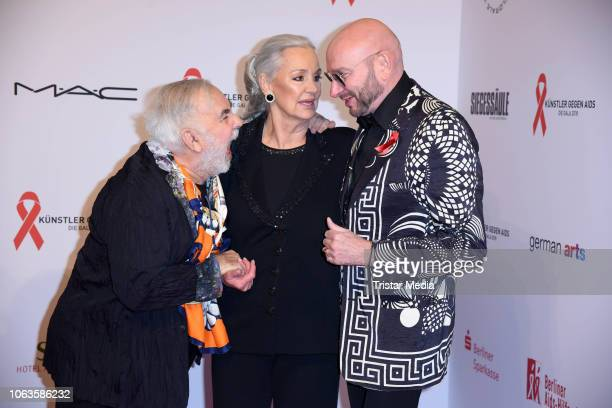 Udo Walz Anja Hauptmann Ralph Morgenstern during the Artists Against Aids Gala at Stage Theater des Westens on November 19 2018 in Berlin Germany