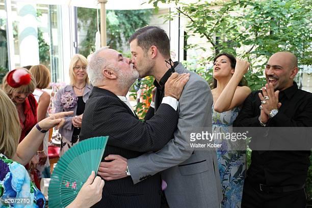 Udo Walz kisses his partner Carsten Thamm as Bettina Zimmermann and Ali Kepenek looks on during the wedding of Udo Walz and his partner Carsten Thamm...