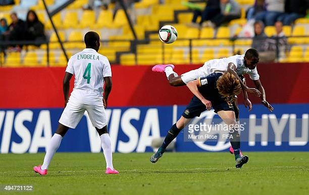 Udochukwu Anumudu of Nigeria and Joshua Laws of Australia battle for the ball during the FIFA U-17 Men's World Cup 2015 round of 16 match between...