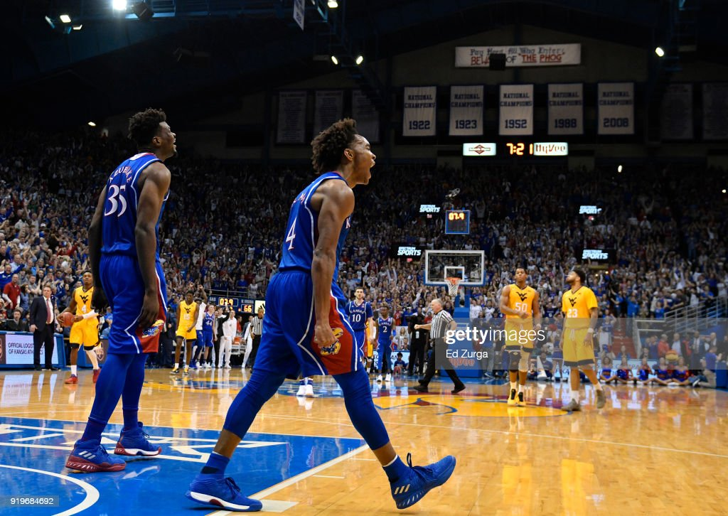 Udoka Azubuike #35 and Devonte' Graham #4 of the Kansas Jayhawks start to celebrate a win against the West Virginia Mountaineers at Allen Fieldhouse on February 17, 2018 in Lawrence, Kansas. Kansas won 77-69.