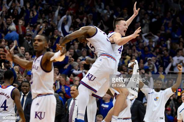 Udoka Azubuike and Mitch Lightfoot of the Kansas Jayhawks celebrate a 7372 win over the Kansas State Wildcats at Allen Fieldhouse on January 13 2018...
