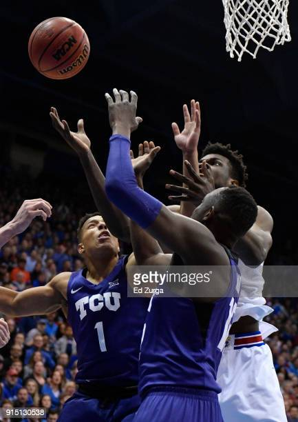 Udoka Azubuike of the Kansas Jayhawks battles for a rebound against Desmond Bane and Kouat Noi of the TCU Horned Frogs in the first half at Allen...