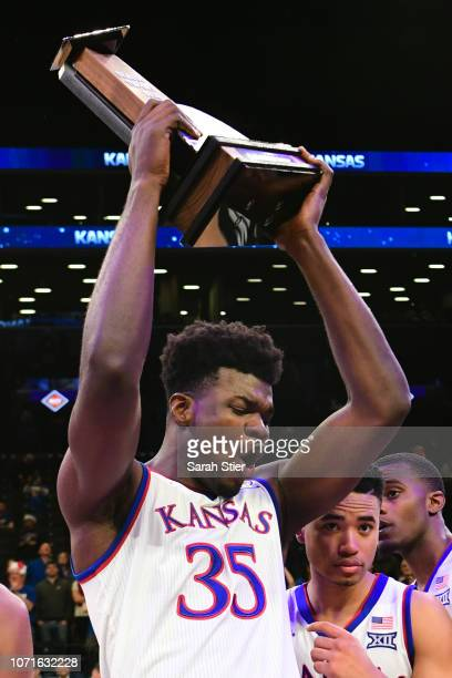 Udoka Azubuike of the Kansas Jayhawks celebrates with the trophy after Kansas' 87-81 win over Tennessee Volunteers at the NIT Season Tip-Off...
