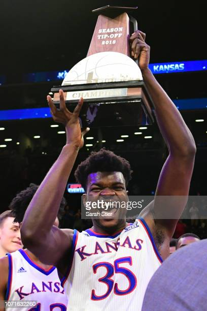 Udoka Azubuike of the Kansas Jayhawks celebrates with the trophy after Kansas' 8781 win over Tennessee Volunteers at the NIT Season TipOff Tournament...