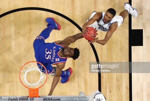 Udoka Azubuike of the Kansas Jayhawks competes for the ball with Mikal Bridges of the Villanova Wildcats in the first half during the 2018 NCAA Men's...