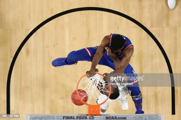 Udoka Azubuike of the Kansas Jayhawks dunks against Dhamir CosbyRoundtree of the Villanova Wildcats in the first half during the 2018 NCAA Men's...