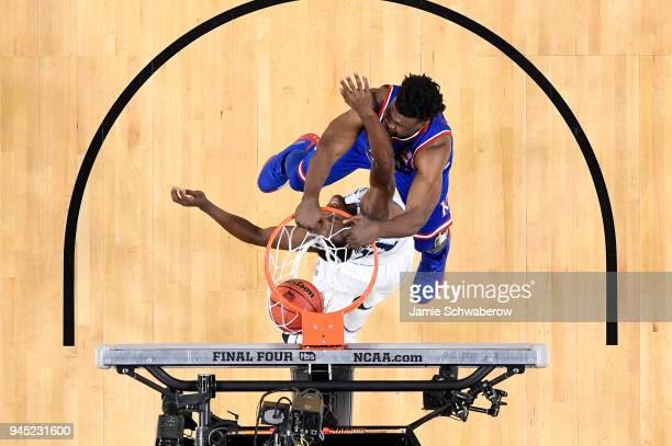 Udoka Azubuike of the Kansas Jayhawks dunks over Dhamir CosbyRoundtree of the Villanova Wildcats during the 2018 NCAA Photos via Getty Images Men's...