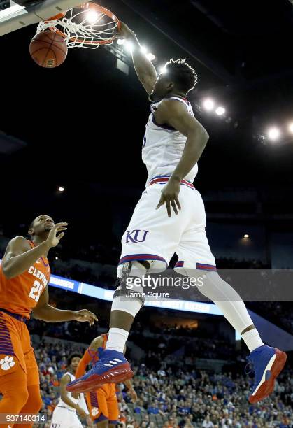 Udoka Azubuike of the Kansas Jayhawks dunks the ball against Aamir Simms of the Clemson Tigers in the 2018 NCAA Men's Basketball Tournament Midwest...