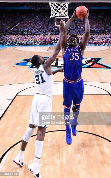 Udoka Azubuike of the Kansas Jayhawks dunks the ball against Dhamir CosbyRoundtree of the Villanova Wildcats during the first half in the 2018 NCAA...