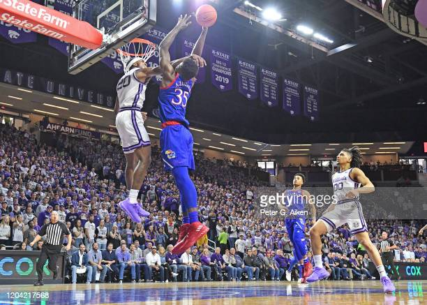 Udoka Azubuike of the Kansas Jayhawks gets fouled by Xavier Sneed of the Kansas State Wildcats during the first half at Bramlage Coliseum on February...