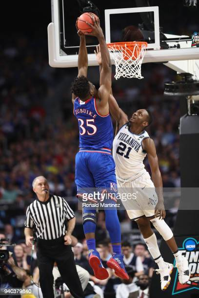 Udoka Azubuike of the Kansas Jayhawks goes up for a dunk against Dhamir CosbyRoundtree of the Villanova Wildcats in the first half during the 2018...