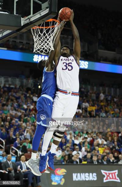 Udoka Azubuike of the Kansas Jayhawks goes up for a shot against Ismael Sanogo of the Seton Hall Piratesin the second half during the second round of...