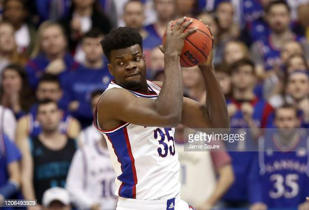 Udoka Azubuike of the Kansas Jayhawks grabs a rebound during the game against the Oklahoma Sooners at Allen Fieldhouse on February 15, 2020 in...