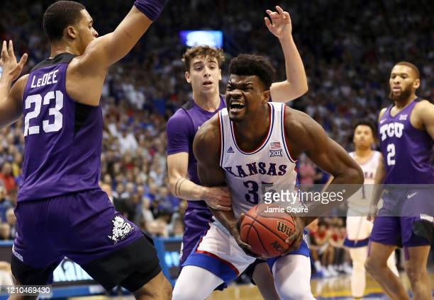 Udoka Azubuike of the Kansas Jayhawks is fouled by Francisco Farabello of the TCU Horned Frogs during the game at Allen Fieldhouse on March 04, 2020...