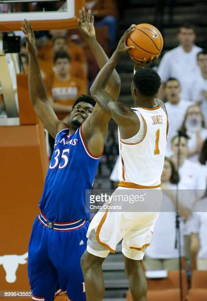 Udoka Azubuike of the Kansas Jayhawks plays defense against Andrew Jones of the Texas Longhorns at the Frank Erwin Center on December 29 2017 in...