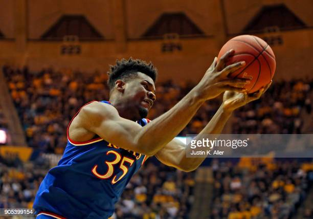 Udoka Azubuike of the Kansas Jayhawks pulls down a rebound against the West Virginia Mountaineers at the WVU Coliseum on January 15 2018 in...