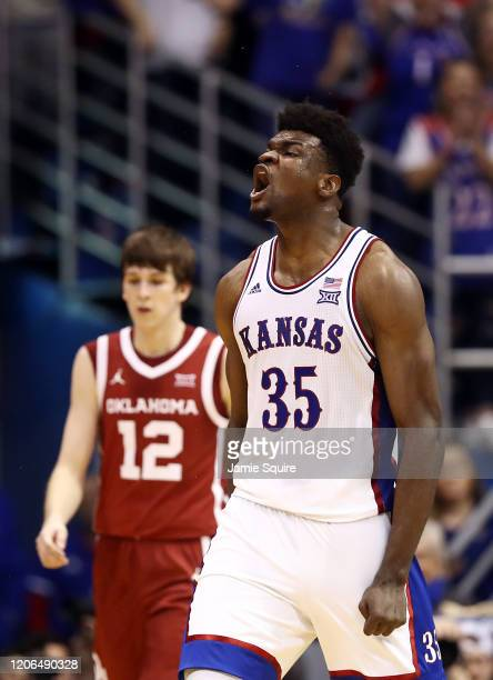 Udoka Azubuike of the Kansas Jayhawks reacts after a dunk during the game against the Oklahoma Sooners at Allen Fieldhouse on February 15, 2020 in...
