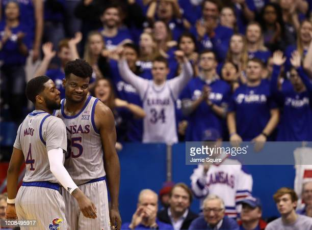 Udoka Azubuike of the Kansas Jayhawks smiles with Isaiah Moss after being fouled during the game against the Oklahoma State Cowboys at Allen...