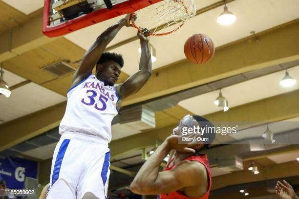 Udoka Azubuike of the Kansas Jayhawks throws down a dunk as Rodney Chatman of the Dayton Flyers clears out during the first half at the Lahaina Civic...