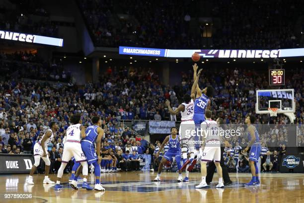 Udoka Azubuike of the Kansas Jayhawks tips off against Marvin Bagley III of the Duke Blue Devils to start the first half in the 2018 NCAA Men's...