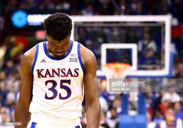 Udoka Azubuike of the Kansas Jayhawks walks off the court during a timeout in the game against the Baylor Bears at Allen Fieldhouse on January 11,...