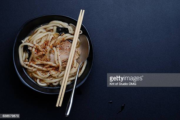 Udon in seaweed soup sprinkled with chili powder