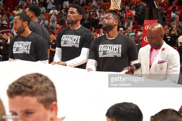 Udonis Haslem and Dwyane Wade of the Miami Heat hold the Marjory Stoneman Douglas HS flag prior to the game against the Memphis Grizzlies on February...