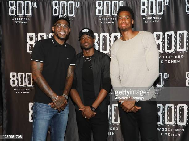 Udonis Haslem Dwyane Wade and Hassan Whiteside attend a VIP Opening Party For Their New Restaurant 800° Woodfired Kitchen on September 13 2018 in...
