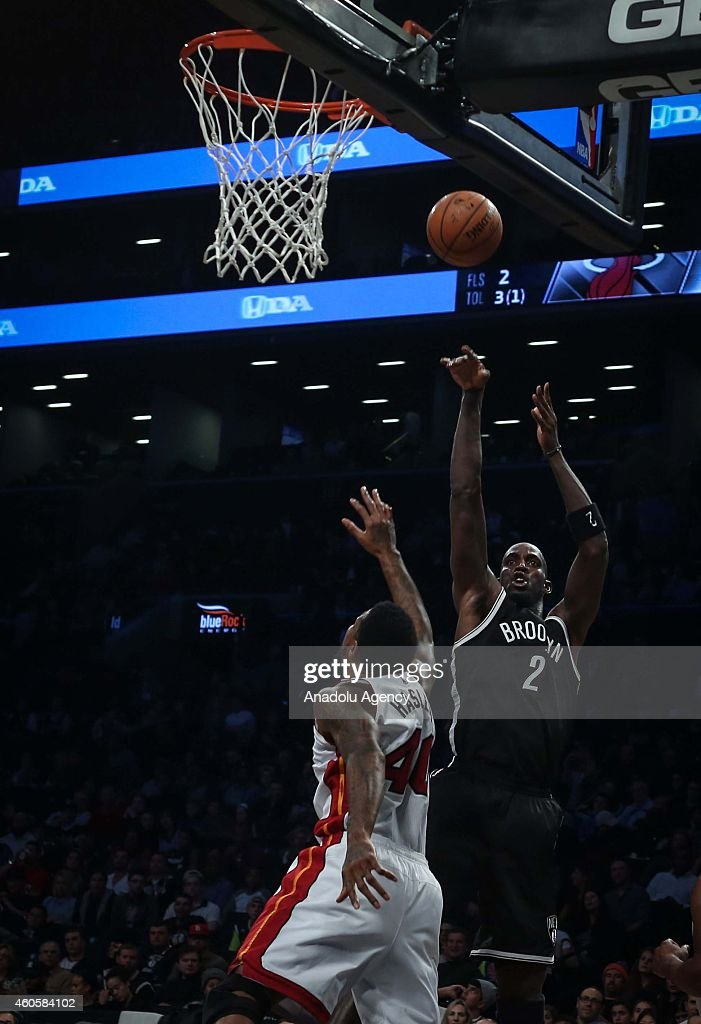 Udonis Haslem #40 of Miami Heat vies with Kevin Garnett #2 of Brooklyn Nets during a basketball game between Miami Heat and Brooklyn Nets at the Barclays Center on December 16, 2014 in the Brooklyn Borough of New York City.
