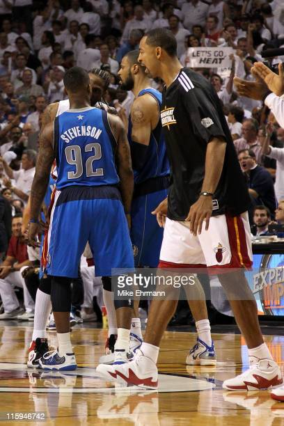 Udonis Haslem of the Miami Heat and DeShawn Stevenson and Tyson Chandler of the Dallas Mavericks get in each others face on the court in the second...