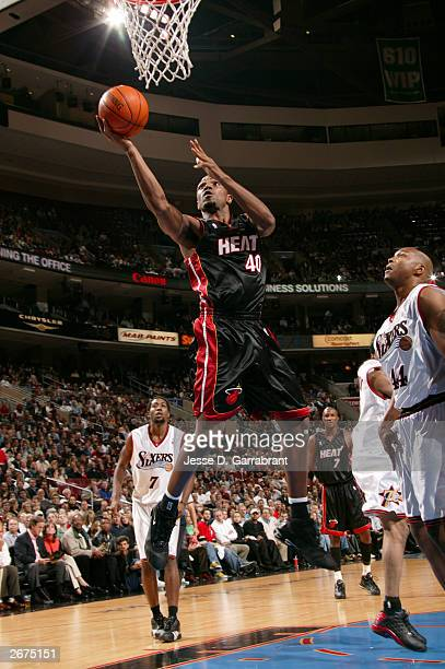 Udonis Haslem of the Miami Heat attempts a shot past Derrick Coleman of the Philadelphia 76ers during a NBA game October 28 2003 at the Wachovia...