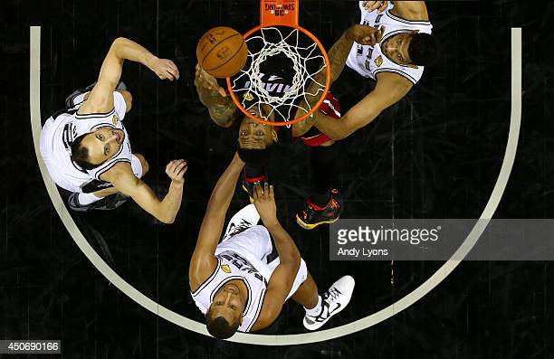 Udonis Haslem of the Miami Heat goes to the basket against the San Antonio Spurs during Game Five of the 2014 NBA Finals at the ATT Center on June 15...