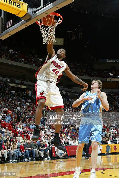 Udonis Haslem of the Miami Heat goes up for a dunk in front of Chris Andersen of the Denver Nuggets during the game at American Airlines Arena on...