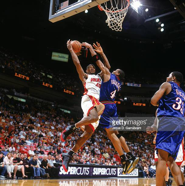 Udonis Haslem of the Miami Heat goes up for the basket against Andre Iguodala of the Philadelphia 76ers at American Airlines Arena on November 21...