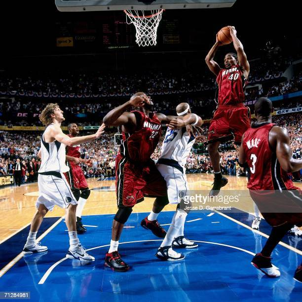 Udonis Haslem of the Miami Heat grabs a rebound against Erick Dampier of the Dallas Mavericks during Game Six of the 2006 NBA Finals played June 20...